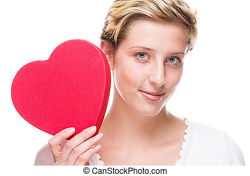 cute young woman holding red heart