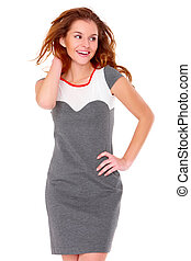 Cute young woman in gray dress on white