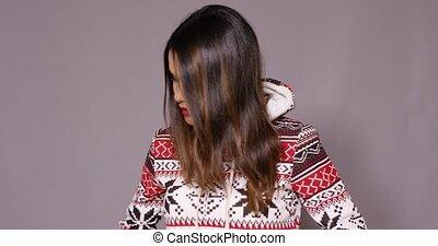 Cute young woman in warm cozy winter fashion
