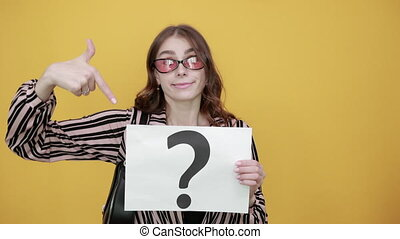 Confused Girl Holding Sheet Of White Paper With Question Mark