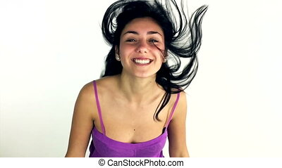 Cute young woman moving hair