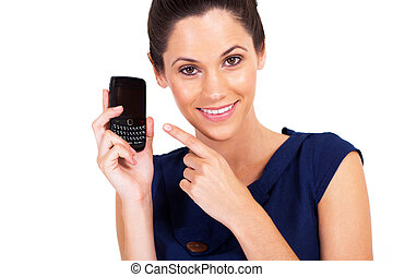cute young woman pointing at smart phone