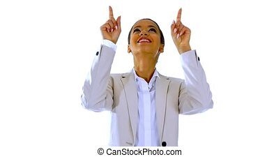 Cute young woman points a finger away - Cute happy smiling...