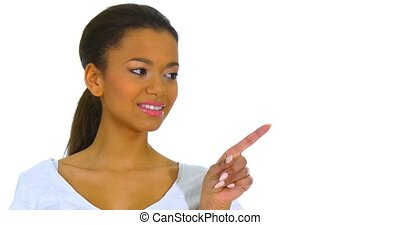 Cute young woman points a finger away - Cute young happy...