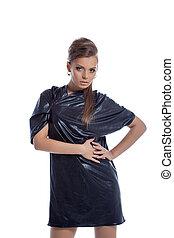 Cute young woman posing in disco dress, close-up