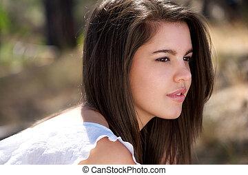 Cute young woman posing outdoors