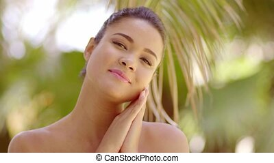 Cute young woman resting cheek on hands - Single cute young...