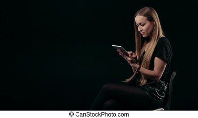 Cute young woman shopping online with touchpad
