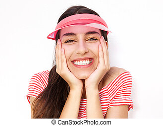 Cute young woman smiling with hands on cheek
