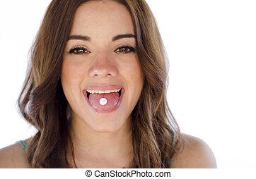 Cute young woman taking an aspirin