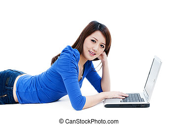Cute young woman using laptop - Portrait of a cute young...