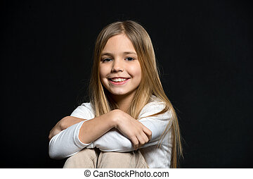 Cuteness overload. Girl long hair cute smiling face relaxing, black background. Smile of this girl amazes with cuteness. Be nice to people. Happiness of little kid filling you positive energy