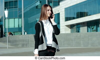 cutie business woman talking on mobile phone
