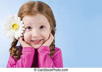 Cutie - Portrait of charming girl with flower in hair ...