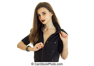 Cutie young woman with beautiful make up unbuttons a black...