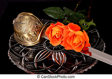 Cutlass and Roses - Cutlass and roses isolated over a black...