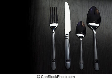 cutlery on a black table