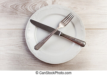 Cutlery on a white plate
