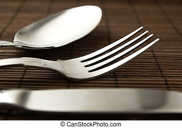 Cutlery on a wooden background