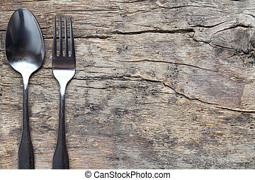 Cutlery on antique wooden board with copy-space