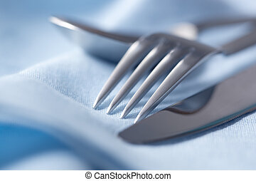 Cutlery on Blue Linen - Knife, fork and spoon on blue linen...