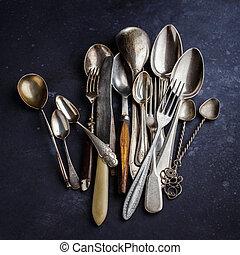 Cutlery on dark blue background