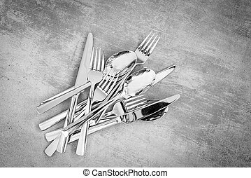 Cutlery on rustic background