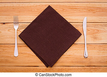 Cutlery red checkered tablecloth tartan on wooden table top view.