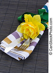 cutlery serving with one daffodil flower