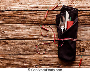 Cutlery Wrapped in Napkin on Wooden Table