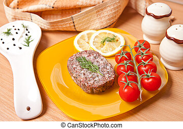 cutlet on a plate with cherry tomatoes