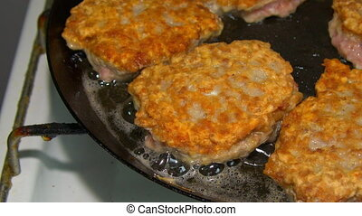 cutlets fried in a pan