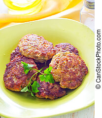 cutlets on the green plate