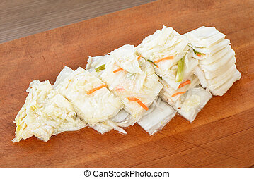 cutted white gimchi on a wooden plate