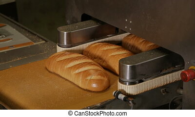 Cutting a loaf of bread into pieces and packing