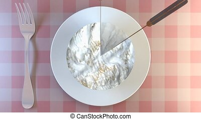 Cutting a portion of creamy cheese on a plate. Eat cheese...