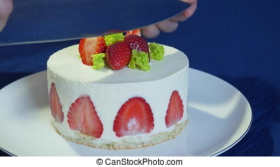 Cutting a Strawberry Wedding Cake with a Knife. Cut the cake. Strawberry cake