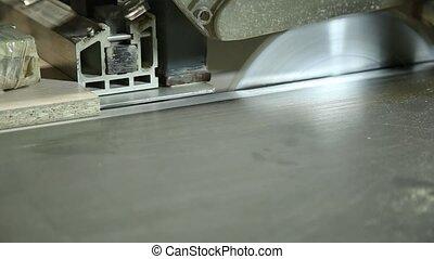 Cutting a wood shield with circular machine