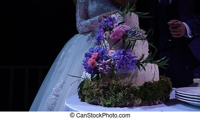 Cutting and folding plates on the wedding cake.