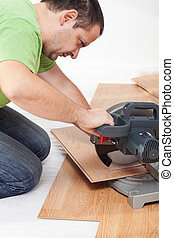 Cutting and laying laminate flooring planks