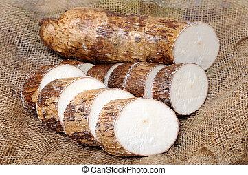 cutting and manioc (cassava) on burlap background
