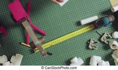 Cutting and welding devices and pvc pipes on the table - ...
