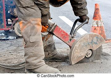 Cutting asphalt road for repairing