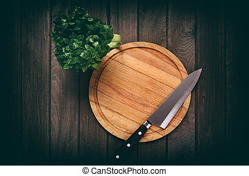 cutting board on a wooden table.