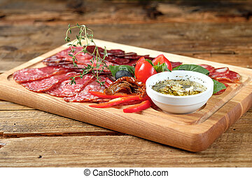 Cutting board with assorted smoked meat