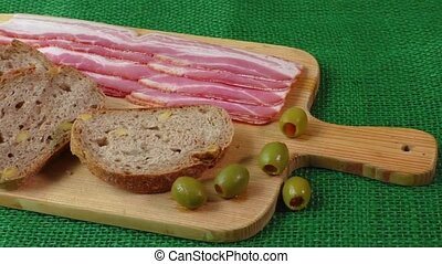 Cutting board with bacon and bread