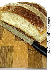 Cutting board with bread and knife