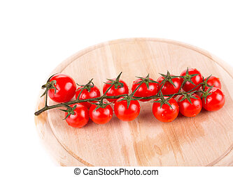 Cutting board with tomatoes-cherry.