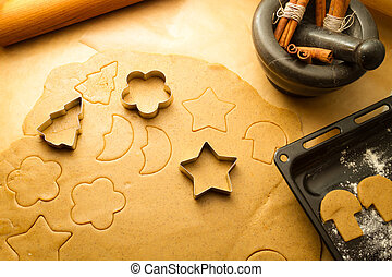 Cutting Christmas cookies made ??of gingerbread