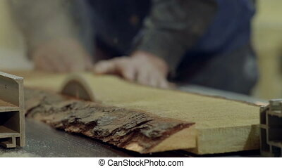 Cutting factory wood - Cutting wood at a wood factory. Close...